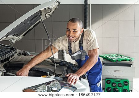 Mechanic auto mechanic working expertise bonnet examining looking