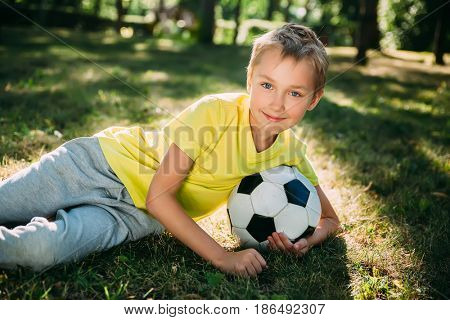 Boy with his ball in the park