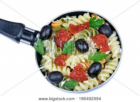 Isolated colorful fusilli with vegetable in a pan on white background