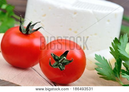 Vegetable with cheese on chopping wooden board