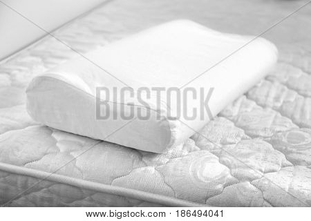 White orthopedic pillow on bed