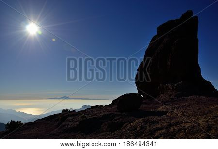 Intense sunset and rock of the frog, Gran canaria, Canary islands