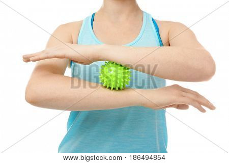 Woman doing exercises with rubber ball on white background, closeup