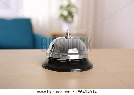 Silver service bell on reception desk