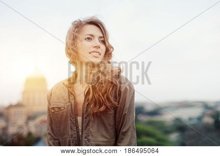 Young Attractive Woman With Good Mood Enjoying Beautiful City Landscape While Standing On A Roof Of