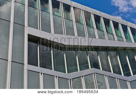 Berlin Germany - July 2015: Unusual architectural detail on a modern building curtain wall and stainless steel cladded facade. Buidling designed by OMA - Rem Koolhaas