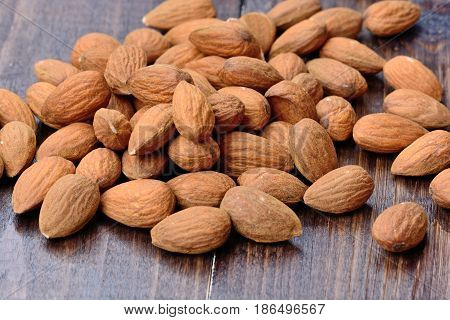 Group of almonds on wooden table close-up