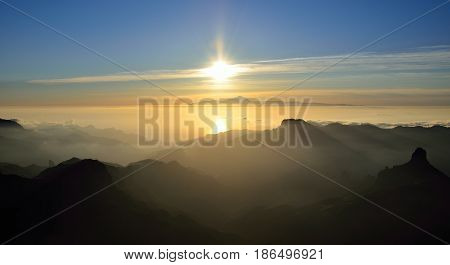 Sunset panoramic from summit of Gran canaria, Roque Bentayga and Tenerife island in background, Canary islands