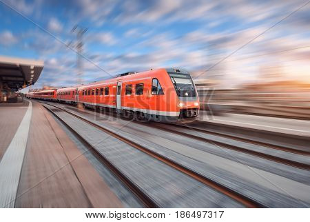 Red Modern High Speed Train In Motion