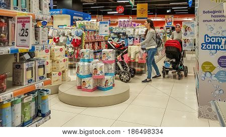 Eskisehir, Turkey - April 08, 2017: Female Customers With Baby Stroller Shopping In Baby Shop Store