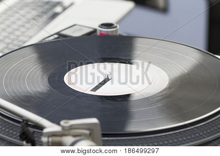 Old vintage vinyl record spinning on turntable