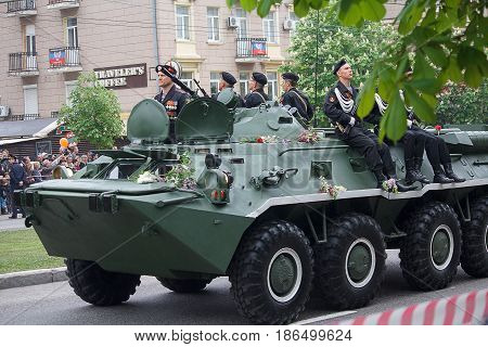 Donetsk Ukraine - May 9 2017: Soldiers of the army of the Donetsk People's Republic on the armored personnel carrier at a military parade in honor of the anniversary of victory in World War II