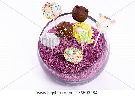 cake pops in vase isolated on white background. colorfull cake pops on white background.