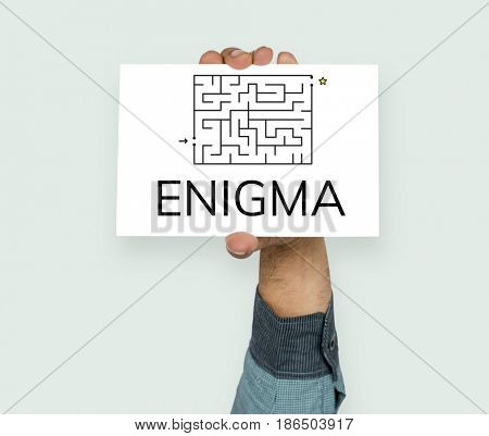 Hand hold enigma concept card