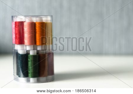 Sewing threads. Blurred background of colourful threads.