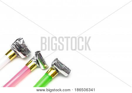 Whistle blowers isolated on white background. Festive noisemakers.