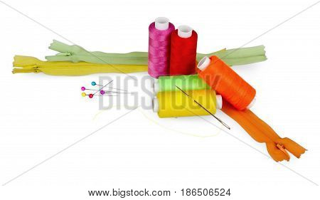 Spools of thread, sewing needle, sewing pins and zippers