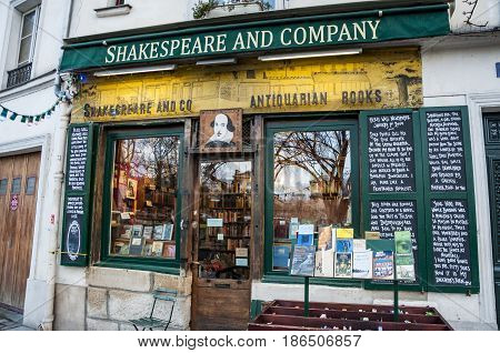 PARIS - MARCH 3: The famous Shakespeare and Company bookstore on March 3 2014 in Paris France. It was featured in the Richard Linklater film Before Sunset and in the Woody Allen's Midnight in Paris.