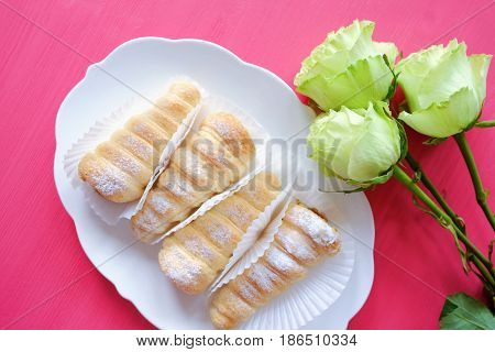 Puff pastry rolls custard tarts and roses