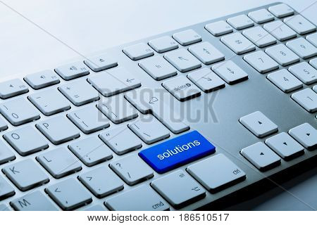 Blue Bottom Solutions on a Keyboard on Grey Background