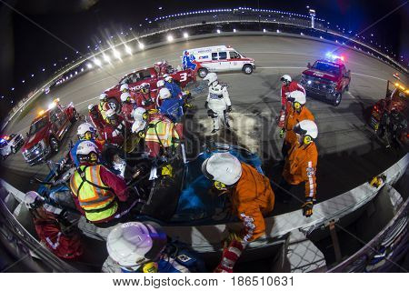 May 13, 2017 - Kansas City, Kansas, USA: Aric Almirola (43) wrecks during the Go Bowling 400 and gets helped out of car at Kansas Speedway.