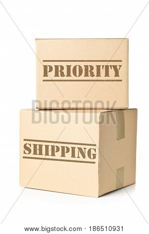 Two corrugated cardboard carton parcels with Priority Shipping imprint