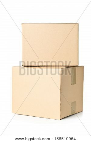 Two corrugated cardboard carton parcels stacked on white background