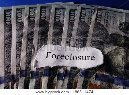 Foreclosure paper news message on cash bills