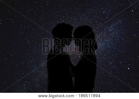 Double exposure of lovely romantic couple. Space love. Black background