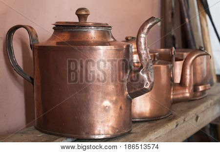 Vintage Copper Teapots Stand On Shelf