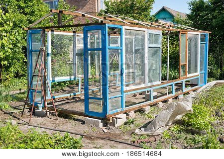 Construction Of A Greenhouse In The Garden From Scrap Materials