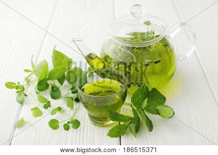 healthy green tea cup with tea leaves