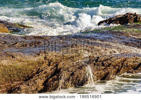 Seawater running through the rocks on Arpoador beach at Ipanema Rio de Janeiro