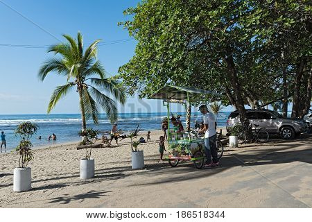 PUERTO VIEJO, COSTA RICA MARCH 19, 2017: Fruit juice sellers at the beach in Puerto Viejo, Costa Rica