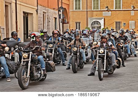 LUGO, RA, ITALY - SEPTEMBER 22: group of bikers riding American motorbikes Harley Davidson during the motorcycle rally