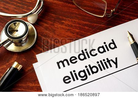 Document with title medicaid eligibility and stethoscope.