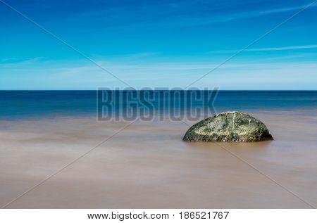 Stony coast of Baltic. Spring on the Latvian coast of the Baltic Sea