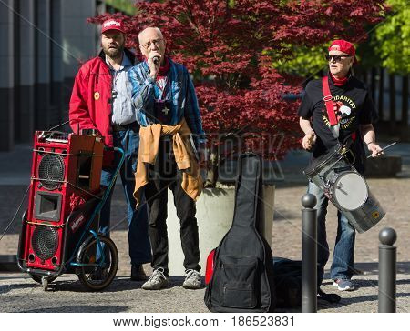 BERLIN - MAY 01 2016: Performance of street musicians. Members of trade unions workers and employees at the demonstration on the occasion of Labour day.