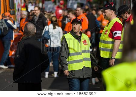 BERLIN - MAY 01 2016: Members of the security services. Members of trade unions workers and employees at the demonstration on the occasion of Labour day.