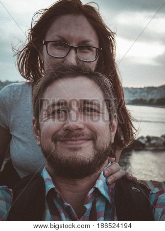 Portrait of happy couple in which on a background of mountains and rivers