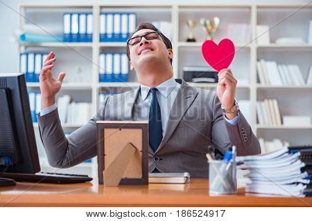 Businessman feeling love and loved in the office