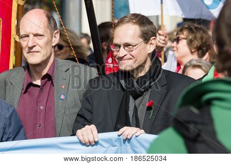 BERLIN - MAY 01 2016: Governing Mayor of Berlin Michael Mueller (center). Members of trade unions workers and employees at the demonstration on the occasion of Labour day.
