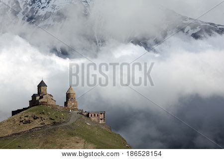 Gergeti Trinity Church Or Tsminda Sameba - Holy Trinity Church Near Village Of Gergeti In Georgia. Church Is Situated At An Elevation Of 2170 Meters Under Mount Kazbegi. Spring Or Summer Season.
