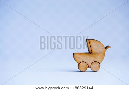 Wooden Icon Of Baby Buggy On Gray Background