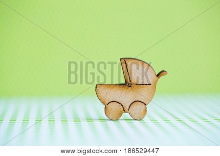 Wooden Icon Of Baby Buggy On Green Background