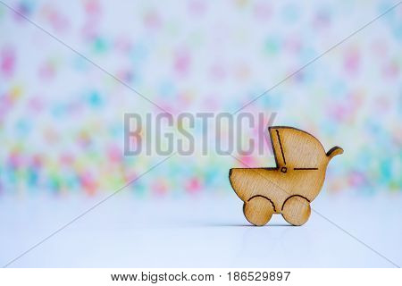 Wooden Icon Of Baby Buggy On Colorful Background