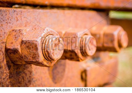 Corrosive Rusted Bolt With Nut. Grunge Industrial Construction Close Up.