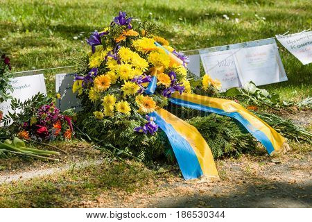 BERLIN - MAY 09 2016: Victory Day in Treptower Park (Soviet war memorial). Crown of the Embassy of Ukraine lies in front of a mass grave of fallen soldiers.