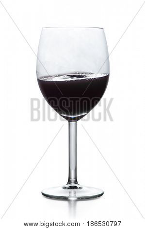 Black liquid in wine glass isolated on white background