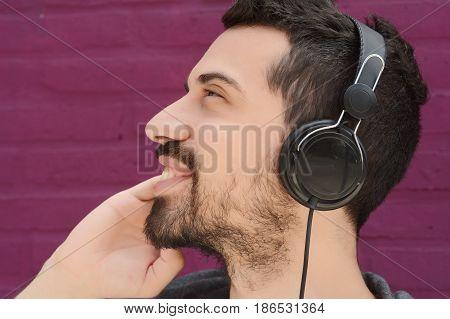 Latin Man Listening Music With Headphones.
